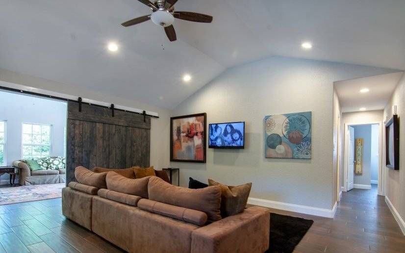 2 living rooms separated by sliding barn door