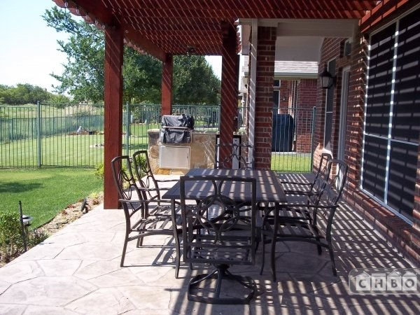 Great backyard patio with built-in grill and golf course vie