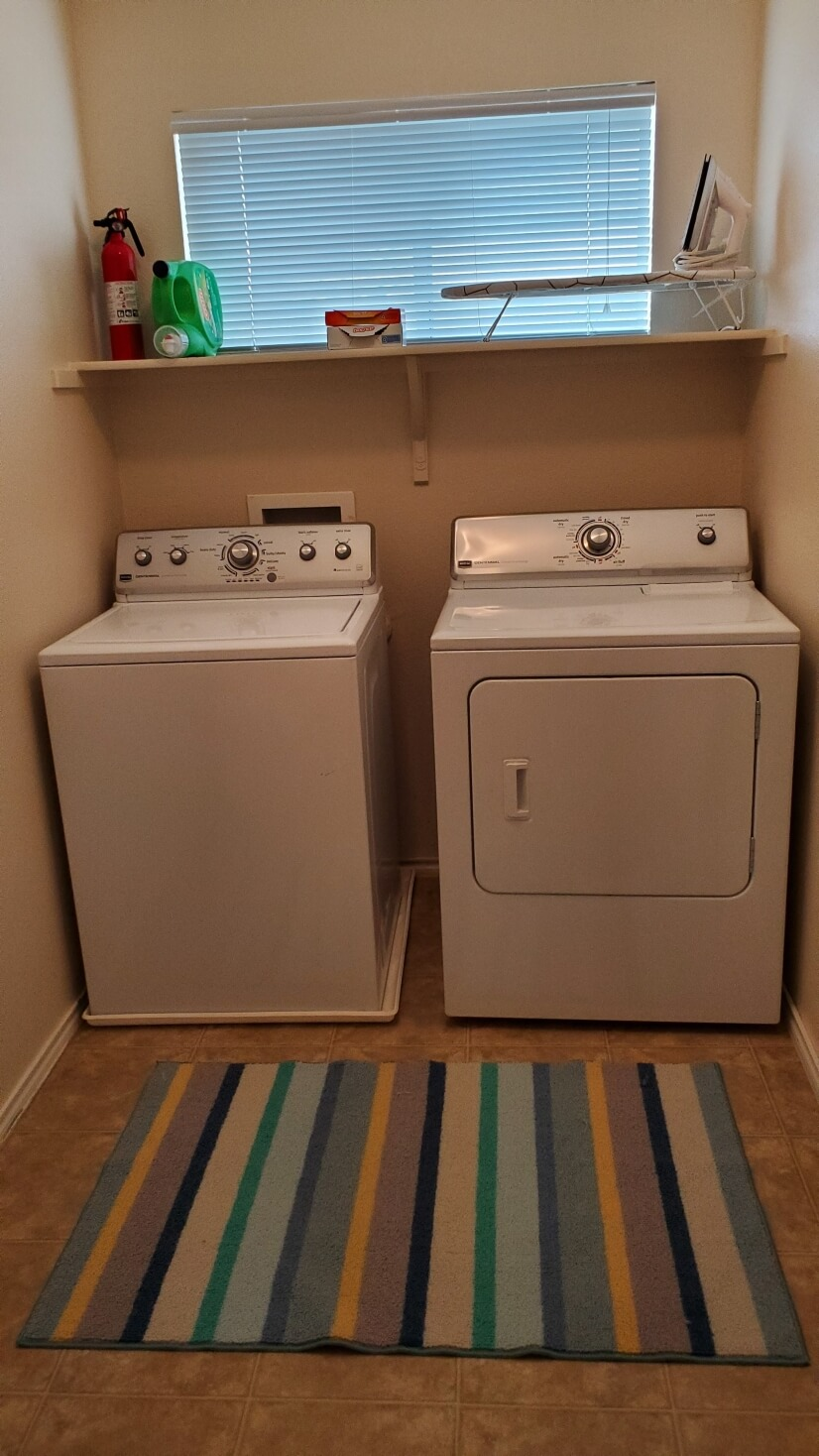 Upstairs laundry room with full-sized washer and dryer