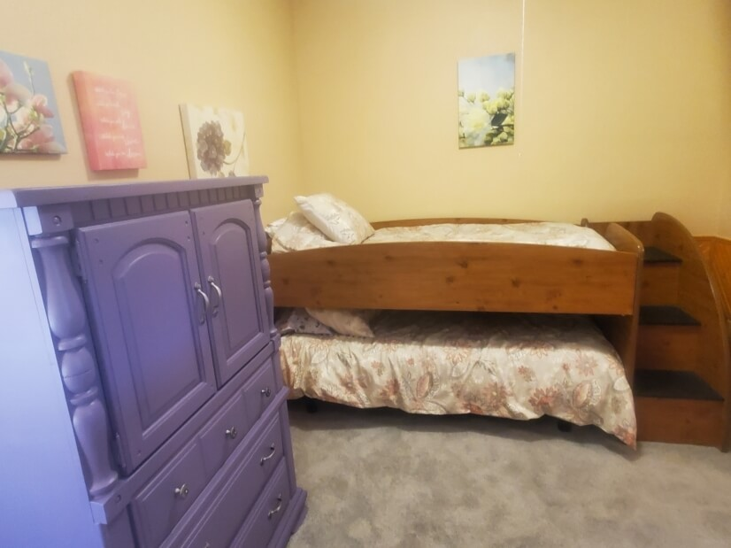 Bed #1 twin bunk beds w/new Purple mattresses
