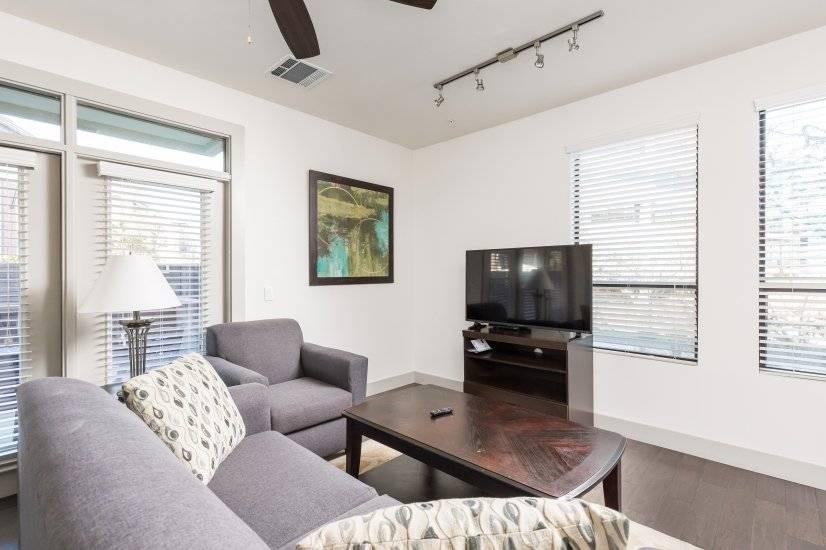 Living room w/ sleeper sofa and Roku TV