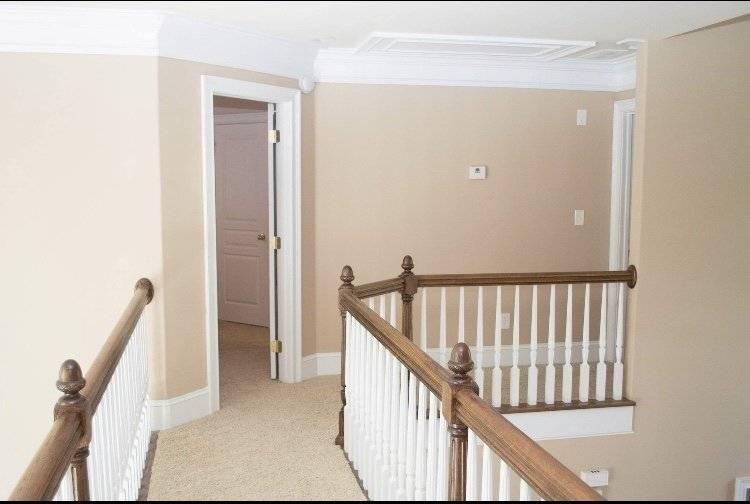 Walkway to twin bedrooms w shared bathroom