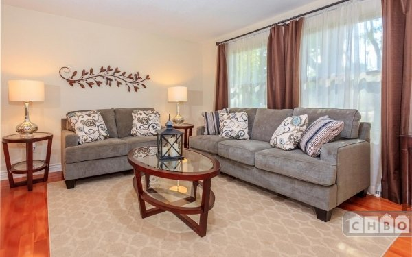 Inviting, comfortable and bright formal living room