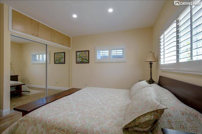 Spacious closet with shelfs and drawers in master bedroom