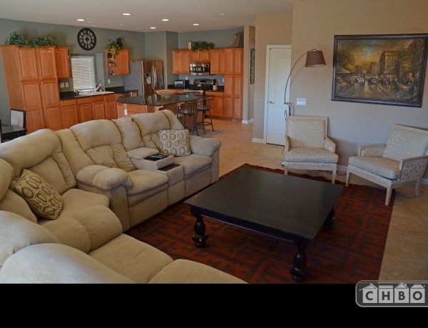 Family Room with couch & four recliners plus smart TV.