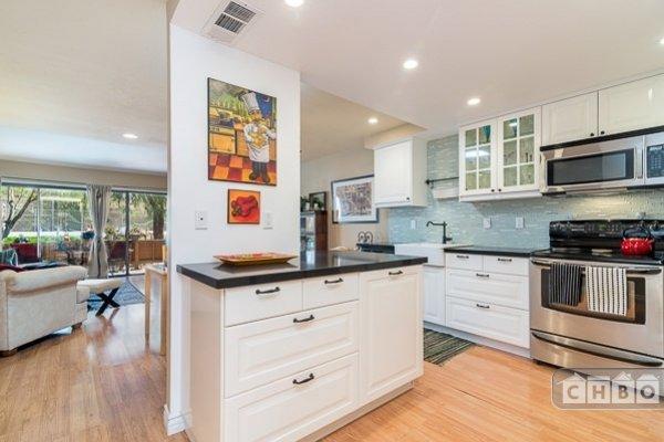Beautiful new kitchen black quartz countertop and glass tile