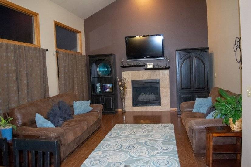 Great Room with fireplace and 55 inch TV