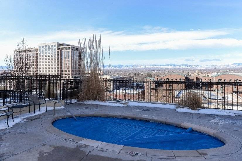 Building hot tub with mountain and city views