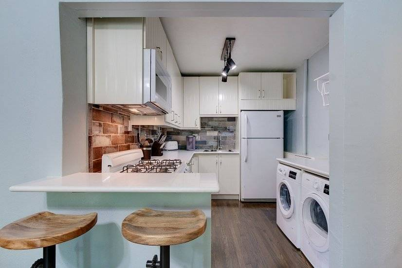 Kitchen with Breakfast stools and Washer/Dryer