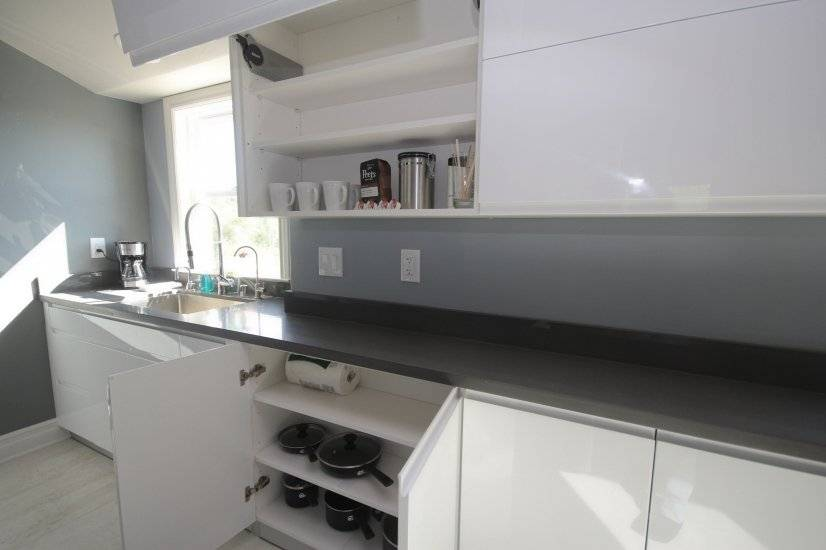 Plenty of cabinets and a variety of cookwares