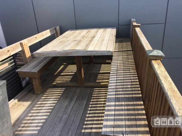 Large roof deck mahogany table and built in benches