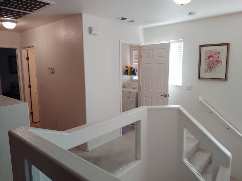 Upstairs hallway & entry to laundry room