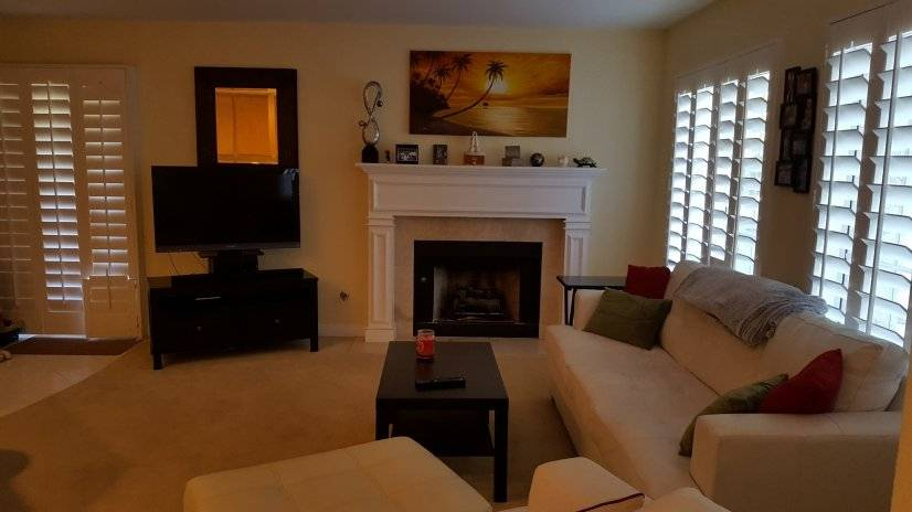 Furnished corporate rental - living room with fire place