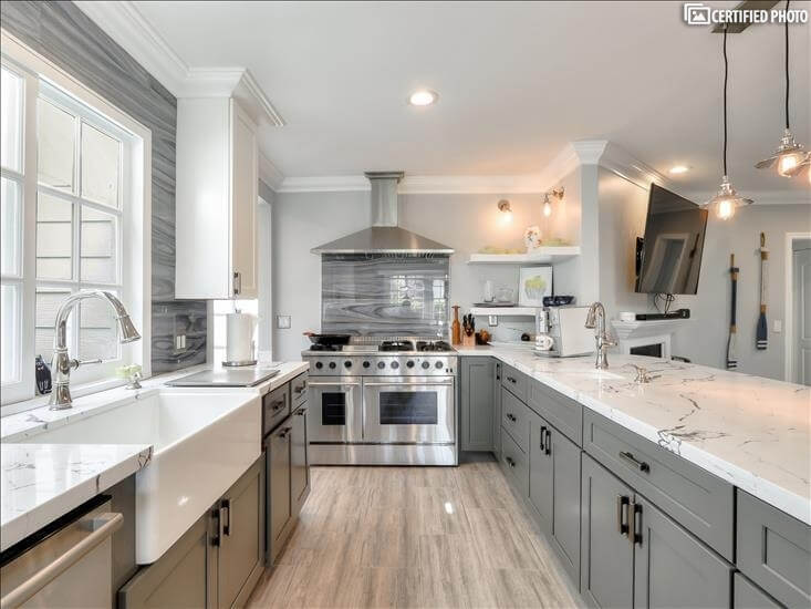 """Kitchen with 48"""" gas range, double oven and griddle"""