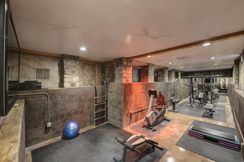 "Fitness center with 56"" HD TV and built in so"