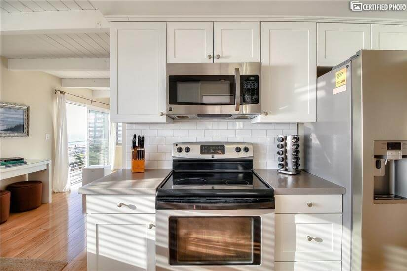 Kitchen with stainless self-cleaning oven and microwave