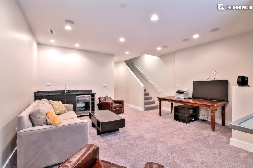 Lower Level Gathering Room/Wet Bar with TV