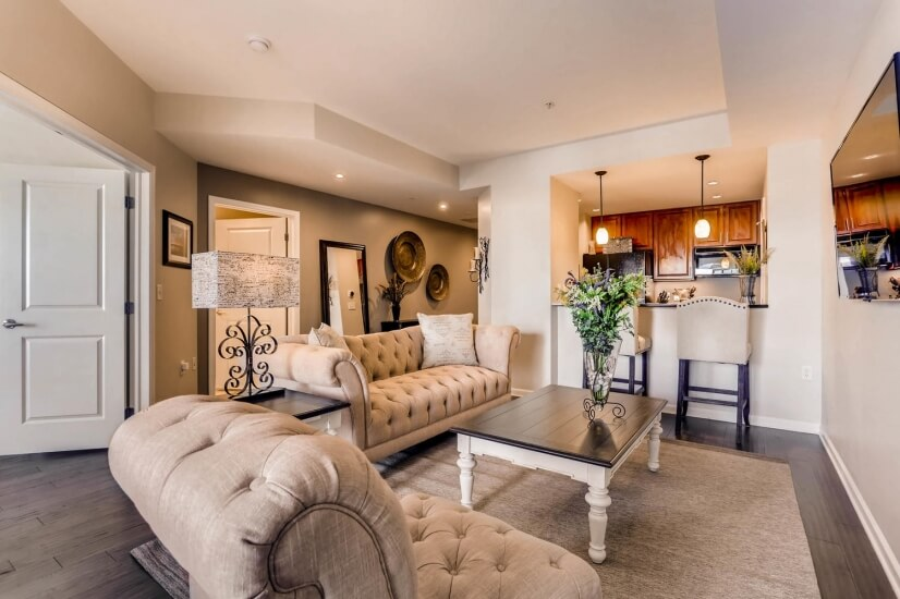 Living room features new upscale furniture and private deck