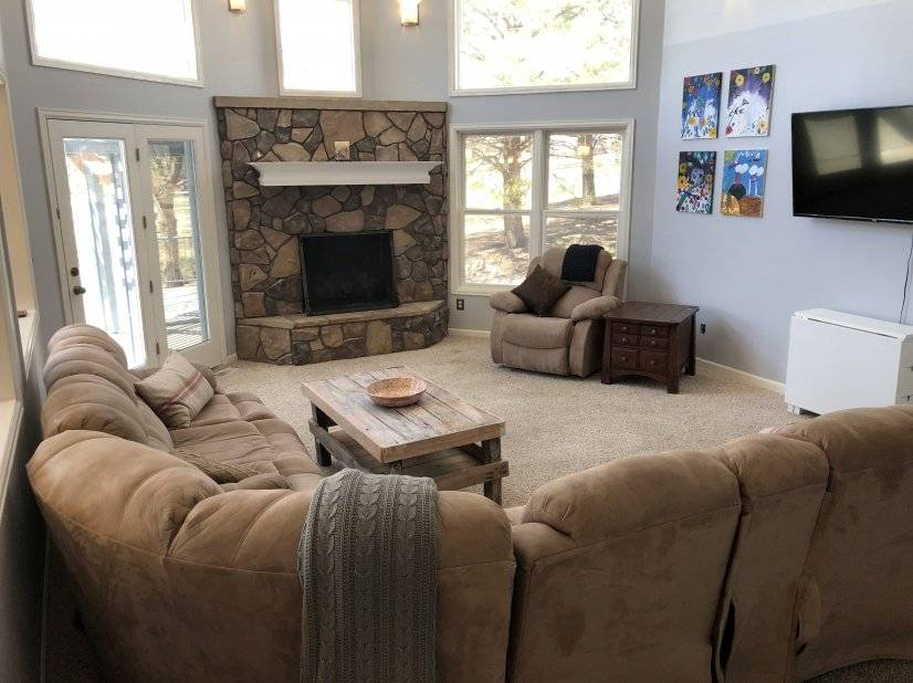 Living room with smart tv, gas fireplace