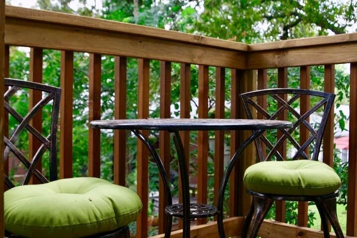 Enjoy a private balcony on top of your small private yard.