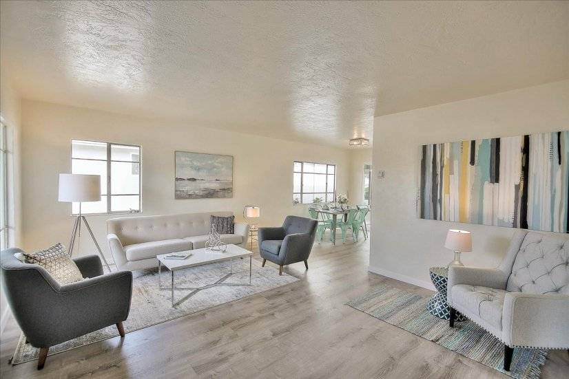 Elegantly furnished living room with new floors
