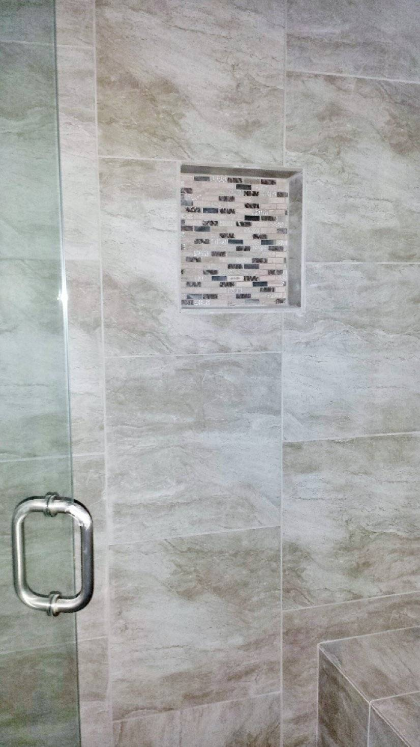 Large walk-in shower with bench, tile surround