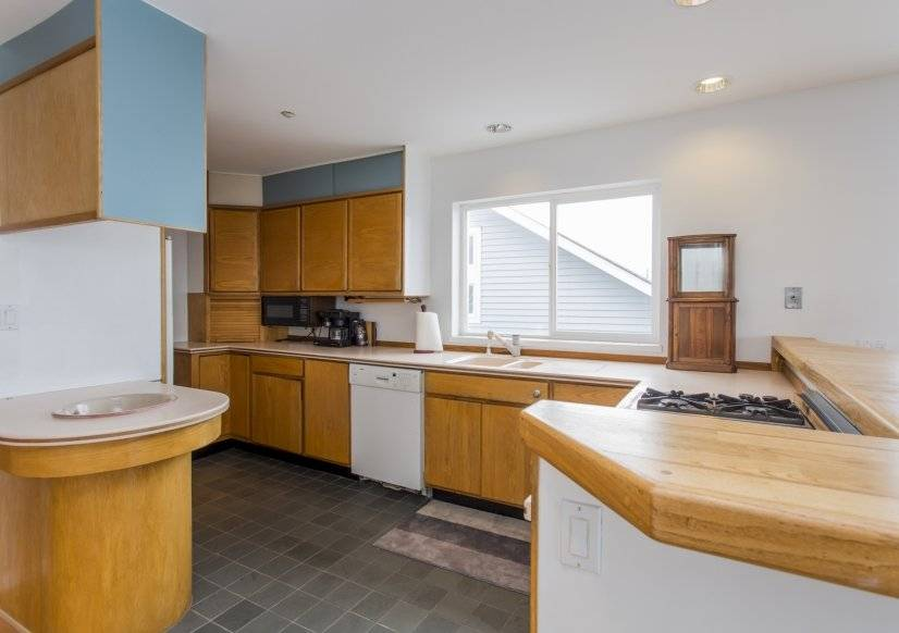 Kitchen with gas range, oven, dishwasher, two sinks, frig