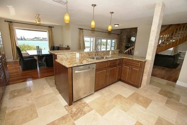 Large open kitchen with exotic granite , bar , wet bar