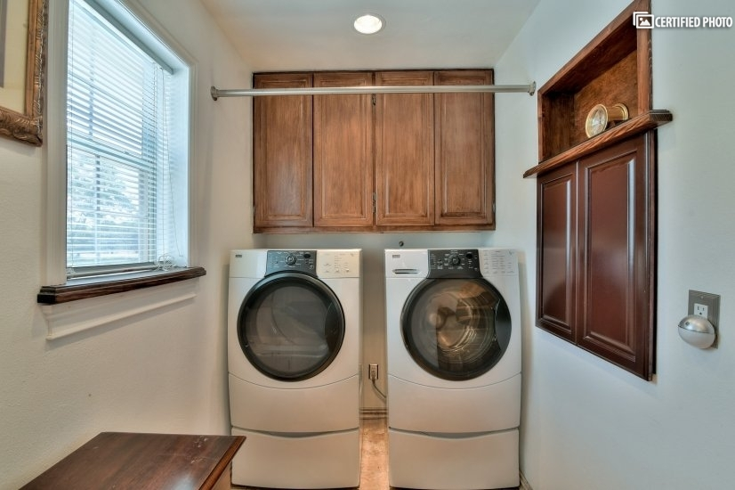 Personal laundry room with drop down folding table.