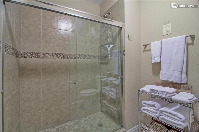 Tiled walk in shower with shower door enclosure