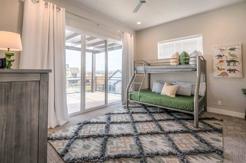 Bunk room with balcony access and pool view