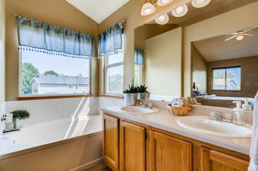 Master bathroom's soaking tub with double sin