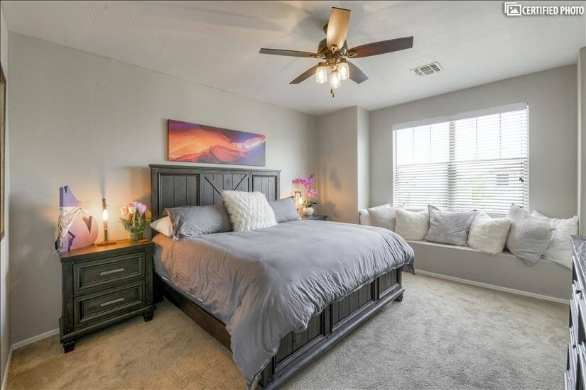 Spacious upstairs bedroom with king size bed.