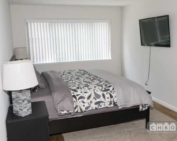 Spacious bedroom with flat screen TV and Roku