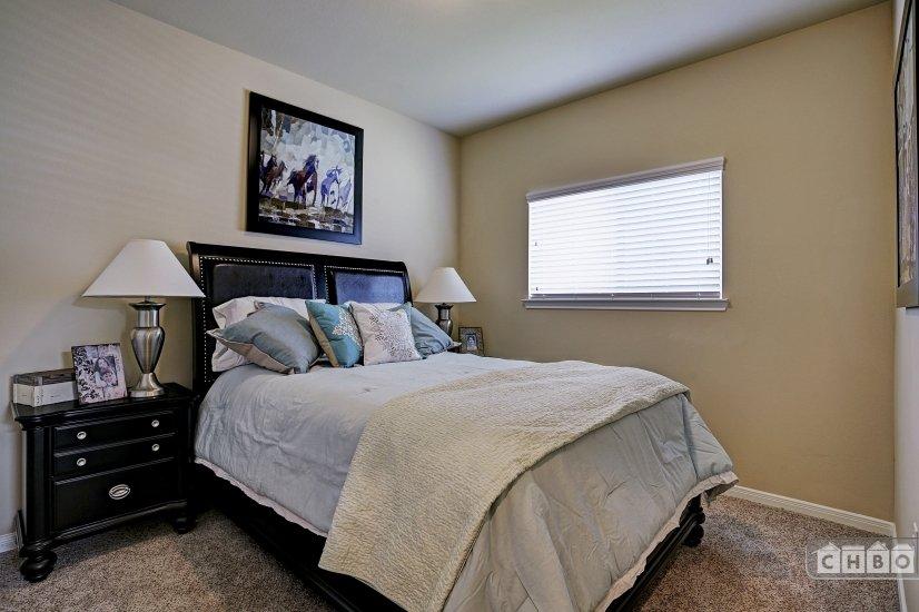 Second bedroom has queen bed.