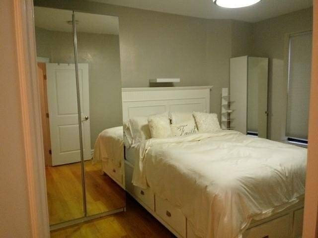 bedroom, ironing board, closet space and storage