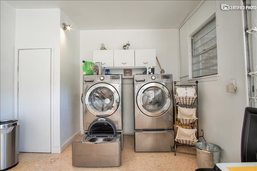 LG washer/dryer combo with additional washer and cubby space