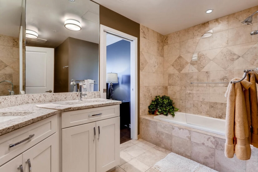 Bathroom features two sinks and a jetted soaking tub