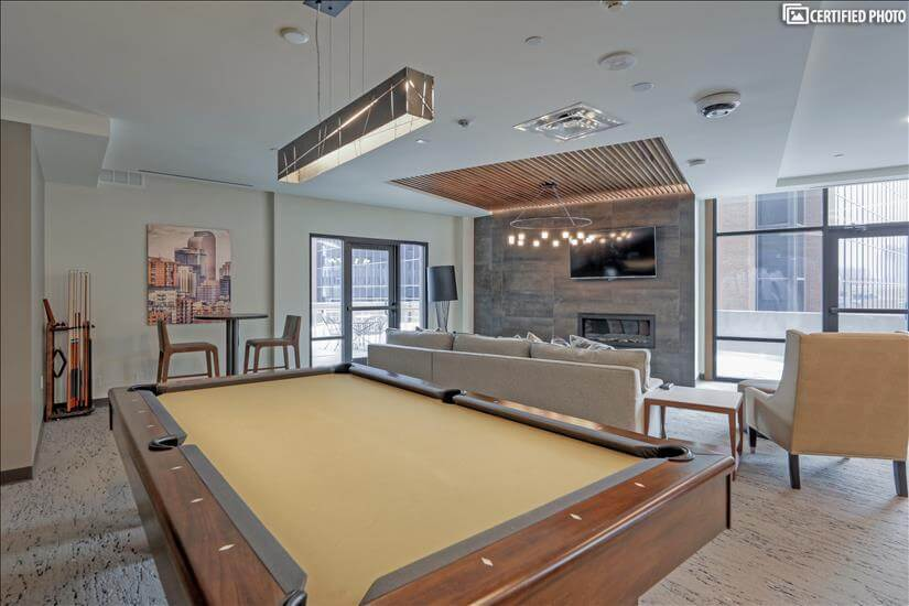 Community room with shuffle board, pool table,grand piano