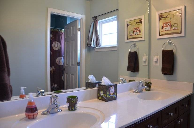 Upstairs double vanity bathroom apart from tub/shower/toilet