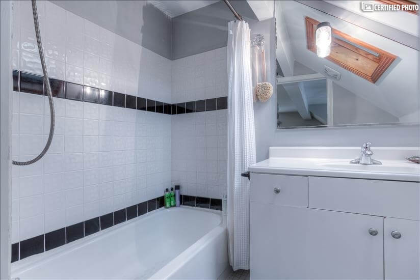 Master bath with classic tile, sun roof