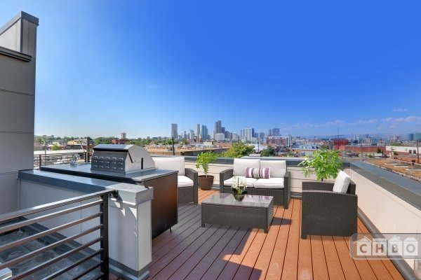 Rooftop deck with outdoor kitchen and furniture