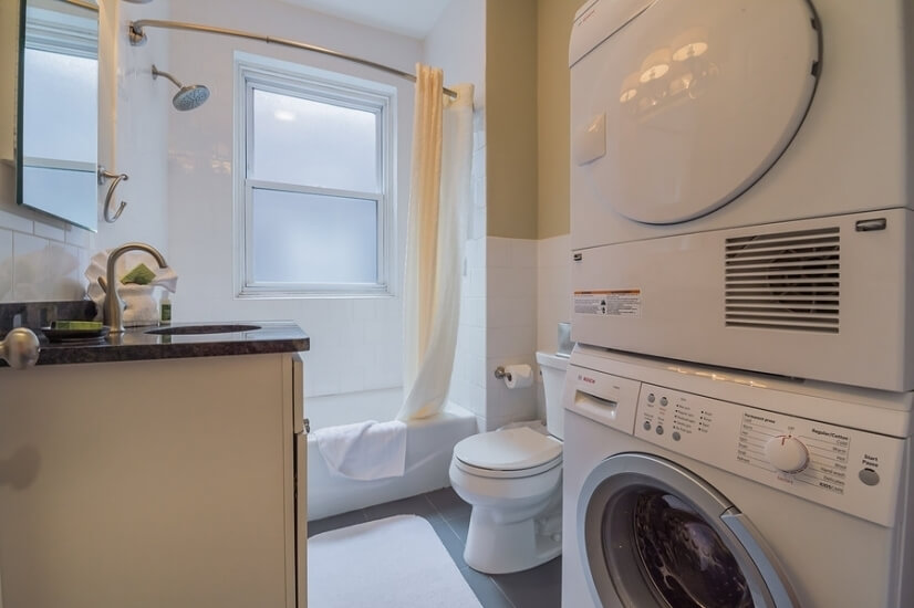 Bathroom with washer/dryer in unti.