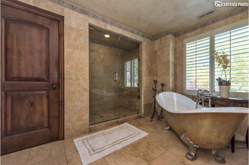 Hand-painted claw legged tub/shower dual heads & a steamer.
