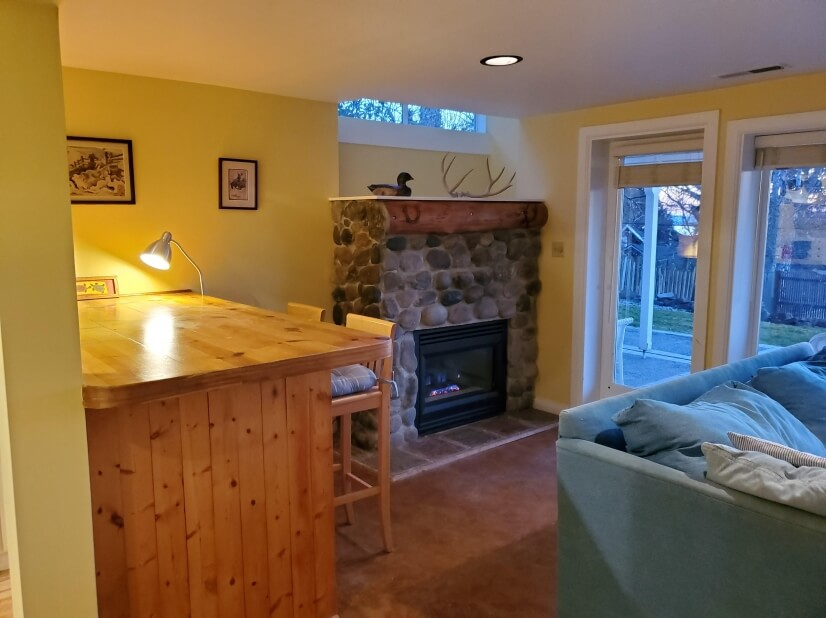 Bar and river rock gas fireplace