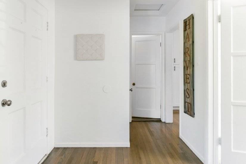 Bathroom straight ahead, bedroom to right