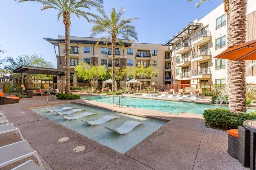 Heated Community Pool & Spa w/ in pool loungers and waterfal