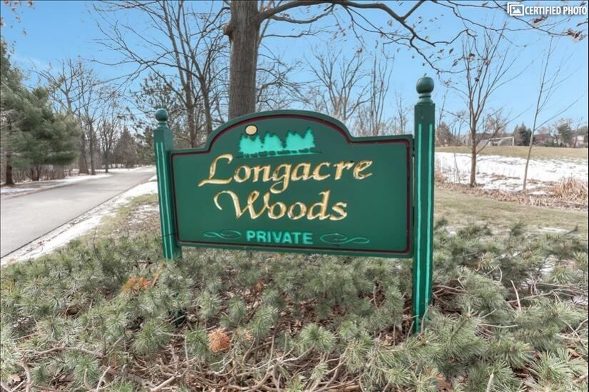 Entry sign into the Longacre Woods area.