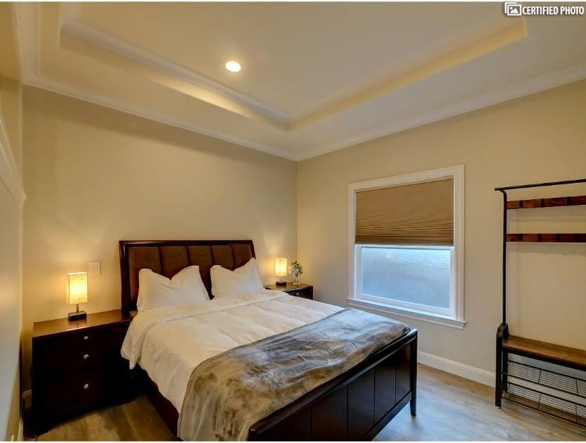 Suite A - Large bedroom with queen size bed.