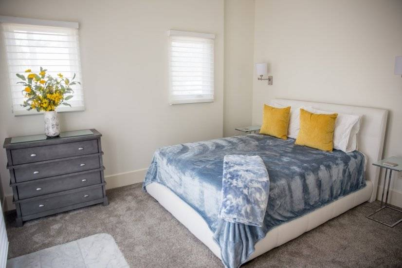 Spacious Bedroom with French Doors opening to Private Patio.